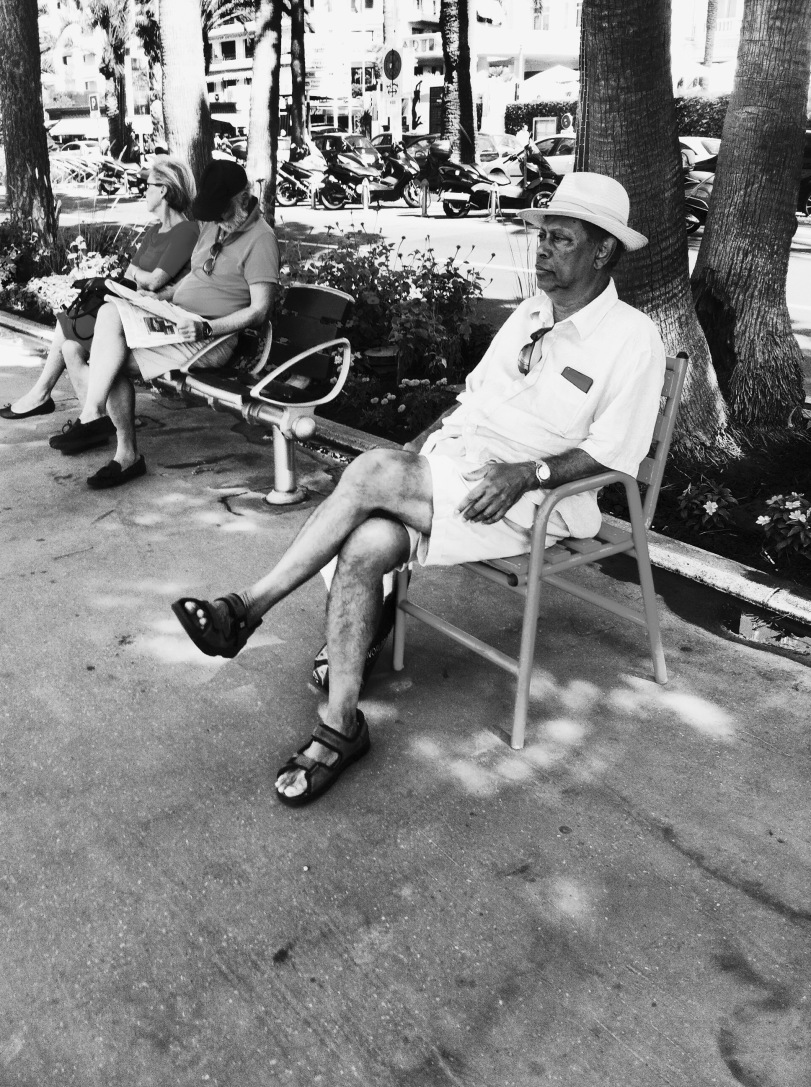 a man sitting on a chair on La Croisette in Cannes - Paul Conneally 2016