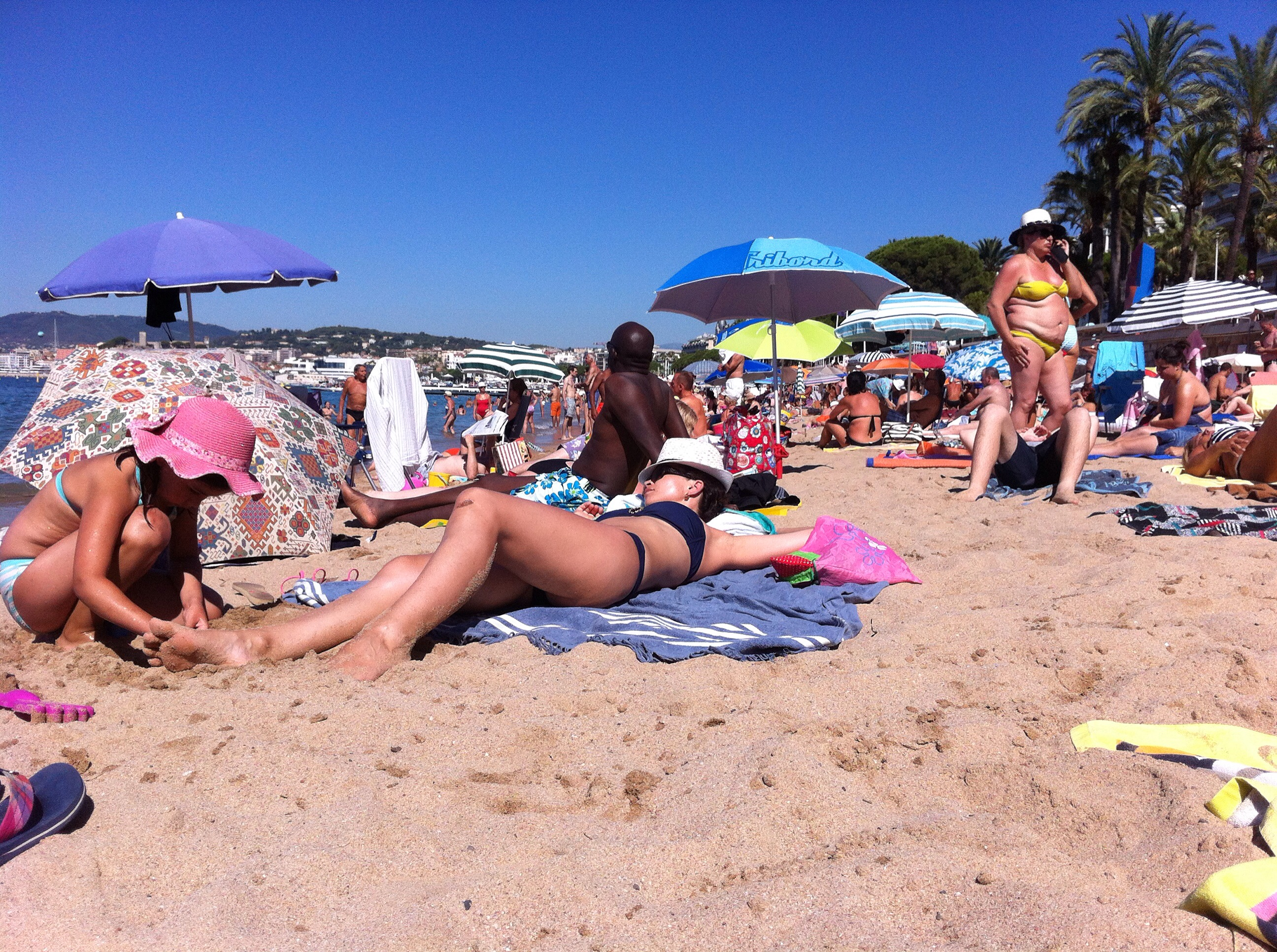 sun seekers on the public beach in Cannes France 2016