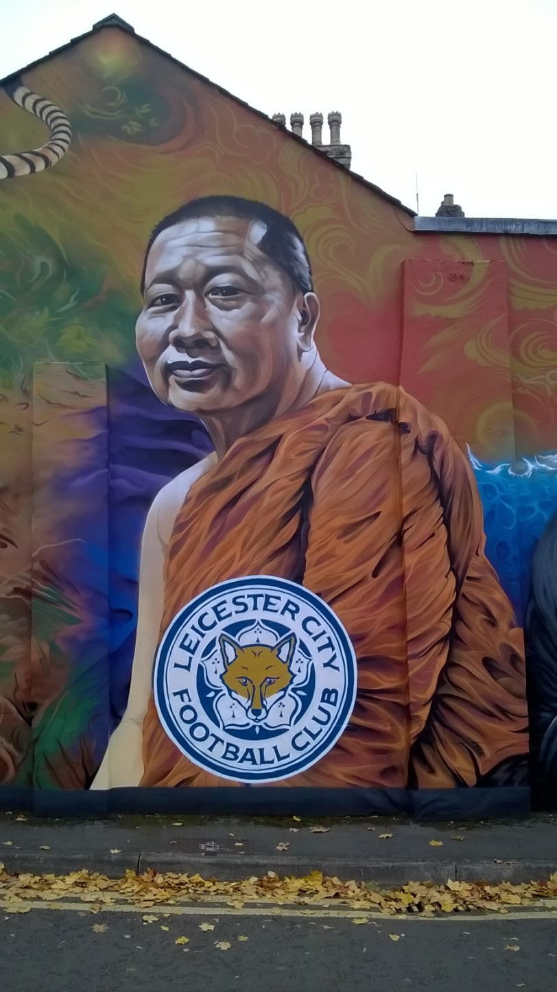 Buddhist monk mural celebrating soccer club Leicester City FC photograph by Paul Conneally