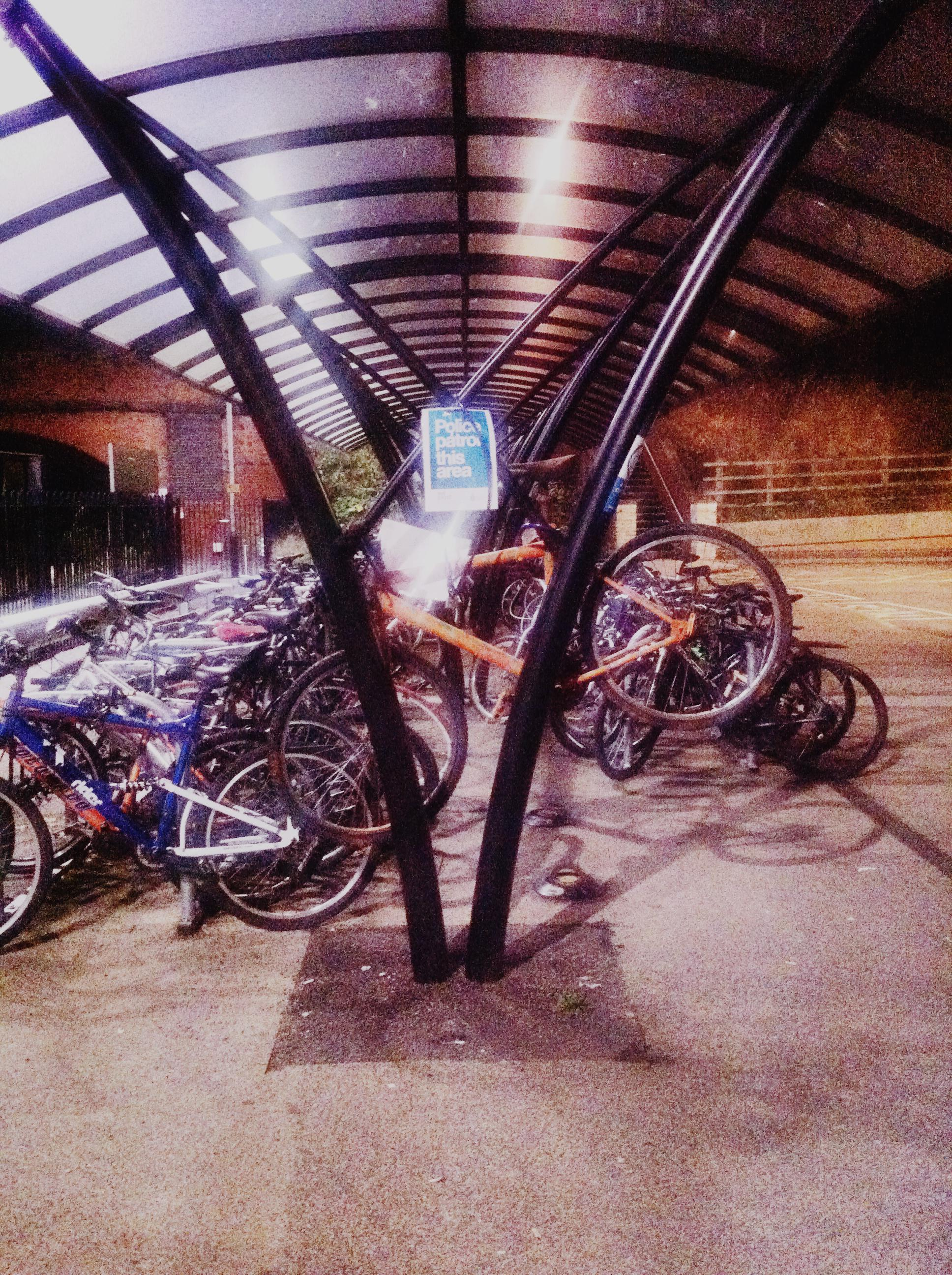 Photograph of bikes in Loughborough Railway Station at night by Paul Conneally